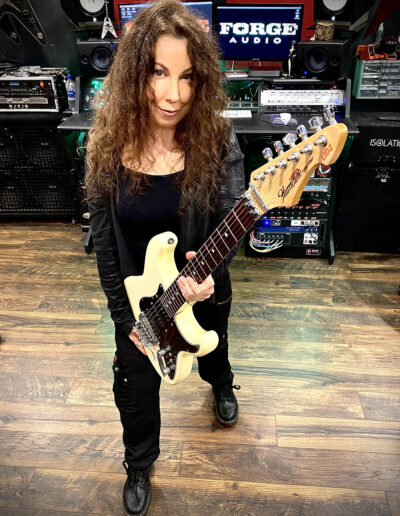 "Laura Christine playing Jason Becker's Hurricane Guitar in Marty Friedman's ""Makenaide"" video"