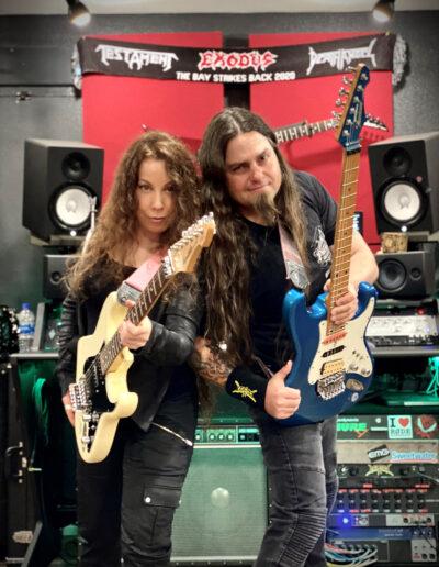 "Laura Christine and Steve Brogden playing Jason Becker's Hurricane Guitars in Marty Friedman's ""Makenaide"" video."